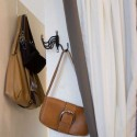 wall hooks and curtains for storing handbags