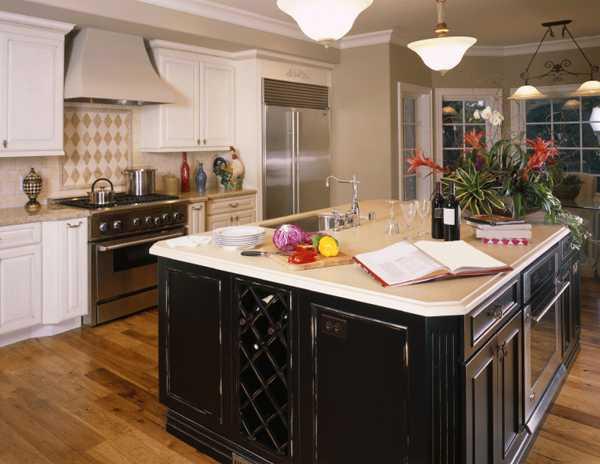 black kitchen island with white countertop