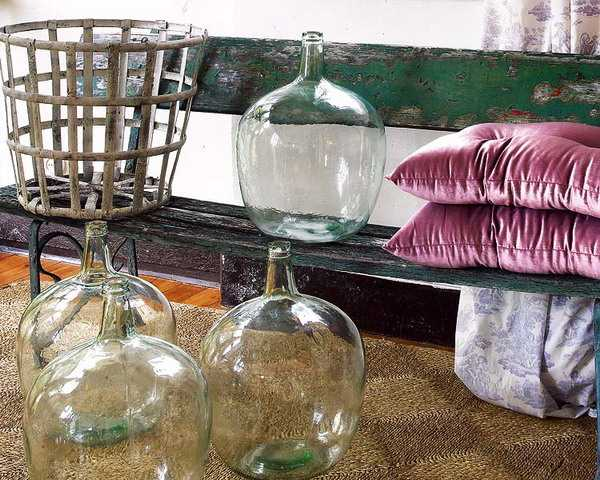 black painted bench and vintage glass jars