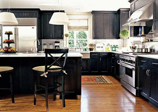 black kitchen cabinets and dining furniture