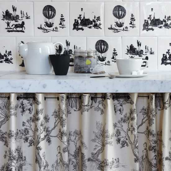 white and black wall tiles and decorative curtain fabric