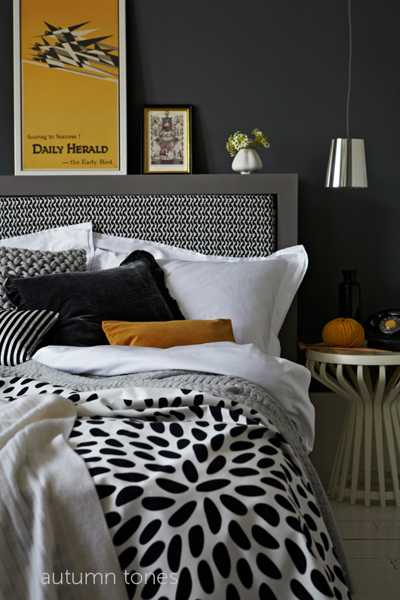 white and black bedding with pillow in yellow color