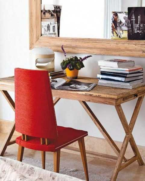 small writing desk and red chair in retro style