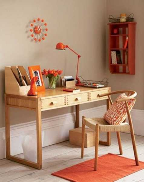 wood writing desk and chair with orange lamp