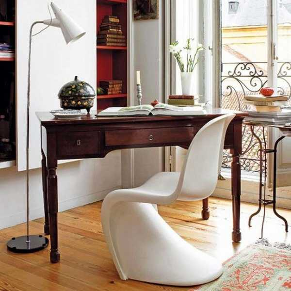antique table and modern chair