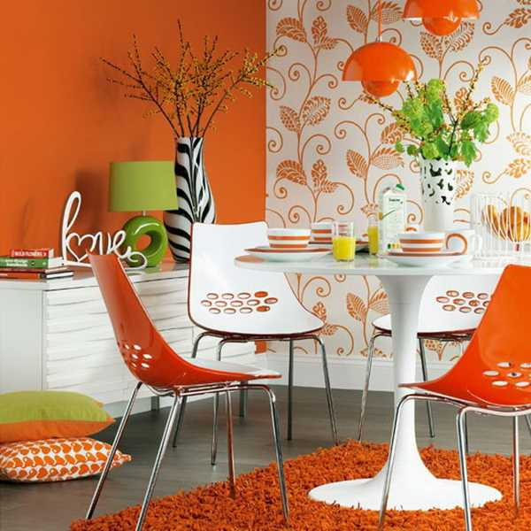 orange wall paint and dining chairs