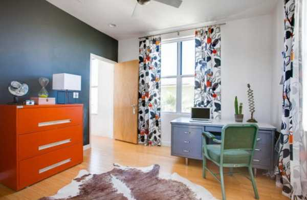 orange furniture and blue wall paint