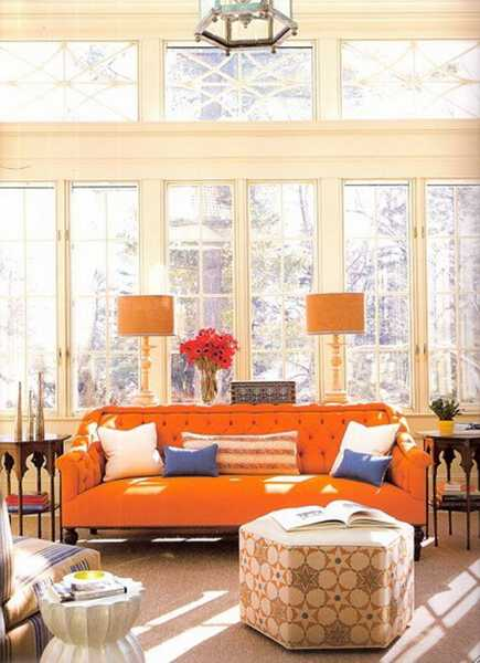 orange lamp shades and orange sofa