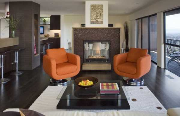 orange chairs beside fireplace