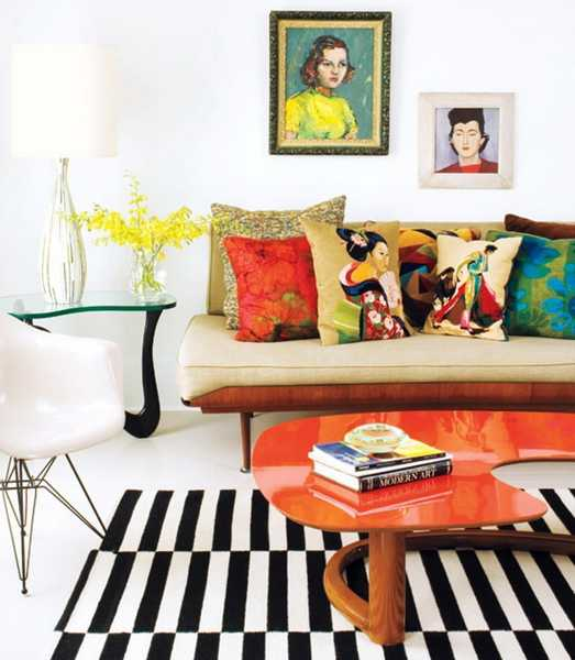 orange coffee table and colorful pillows