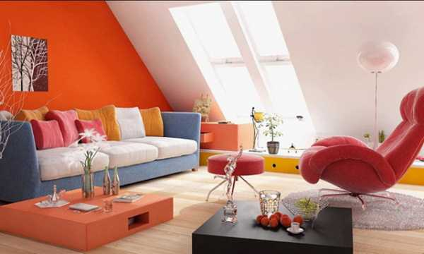 orange wall paint and blue sofa