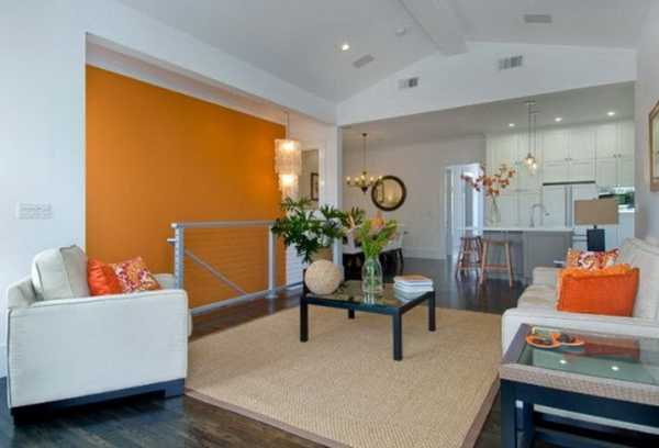 orange wall paint and white living room furniture