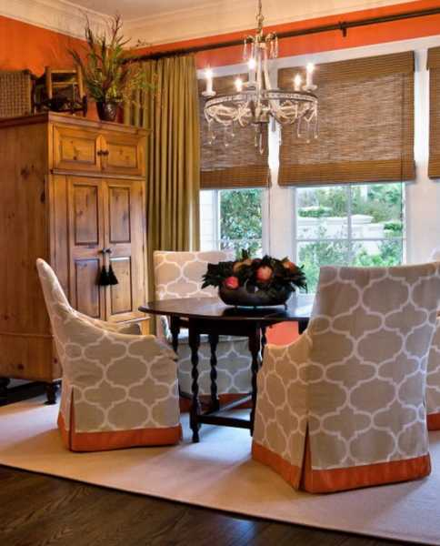 orange accents on dining chair covers