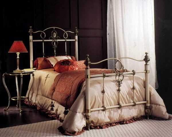 bed in classic fabrics with beige comforter
