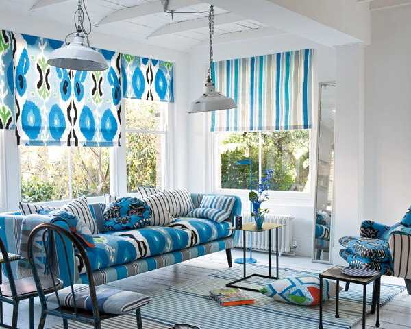 blue window shades and sofa upholstery fabric with ikat pattern and