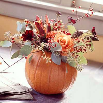 pumpkin with flower arrangement