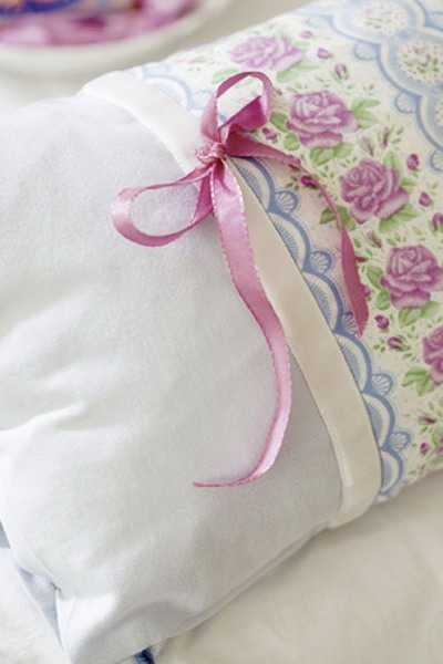 pillow decorating with ribbons and lace
