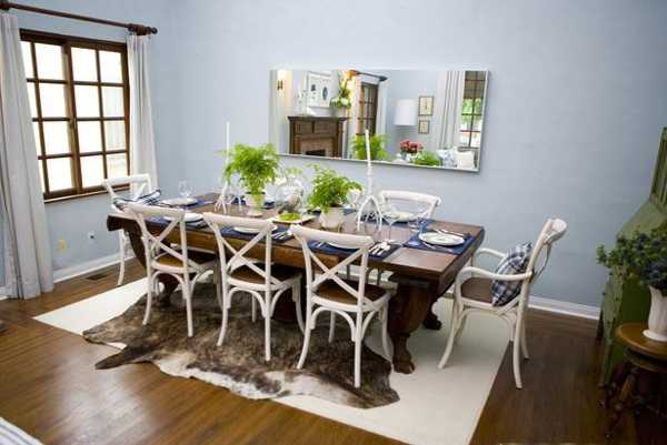 solid wood dining table and white chairs