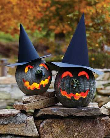 black pumpkins in witch hats