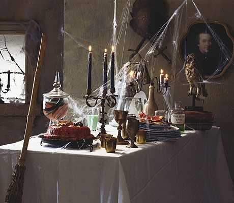 halloween party decorations witch broom and black candles