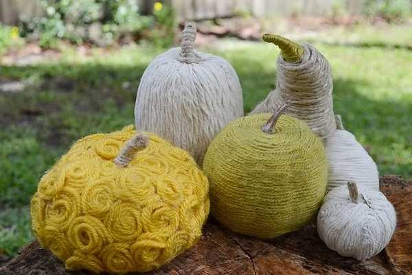 green white and yellow pumpkins made of yarn