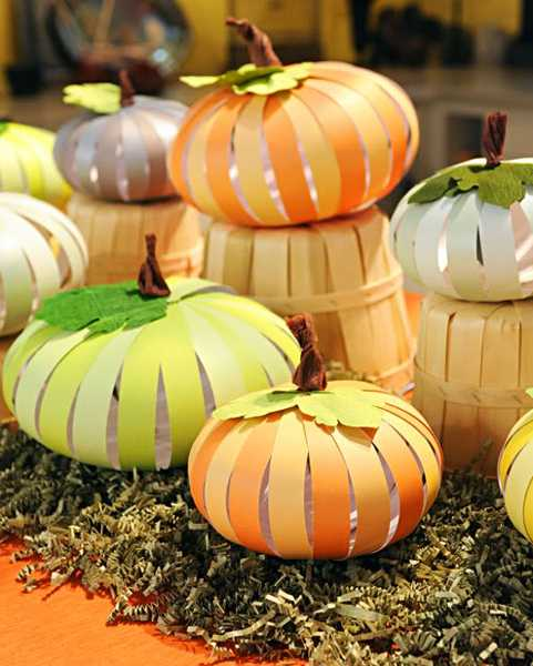 green and orange pumpkins made of wood or cardboard stripes