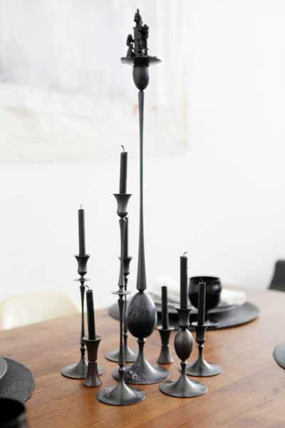 black candles and candle holders