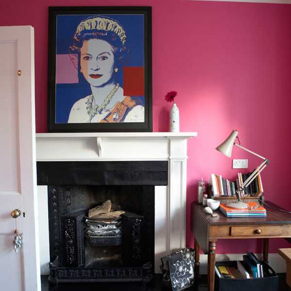 pink wall paint and white fireplace