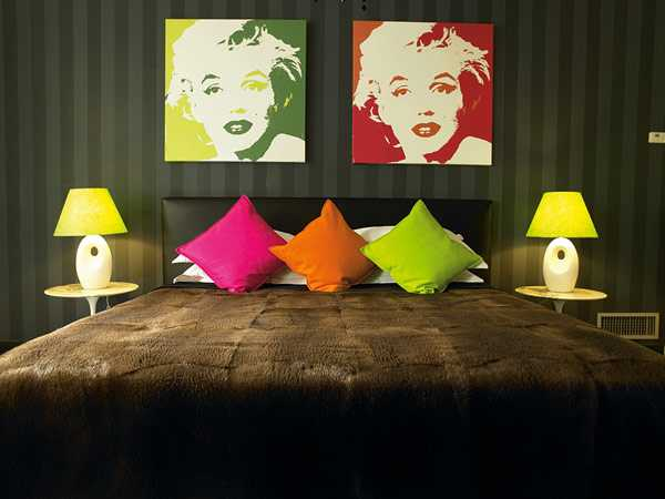 decorative pillows and wall art in bright colors