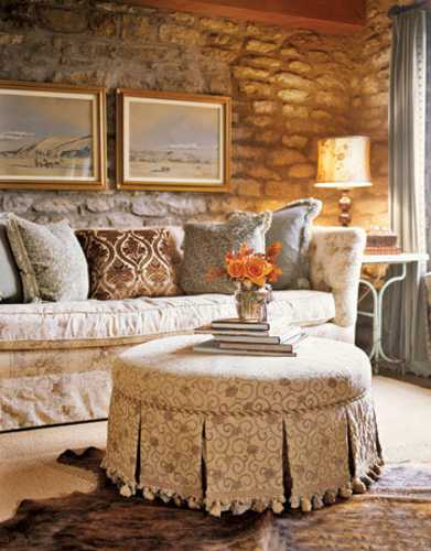 living room with stone wall and brown fabrics