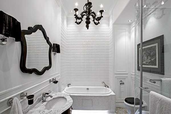 white bathroom design with black chandelier and mirror frame in modern style