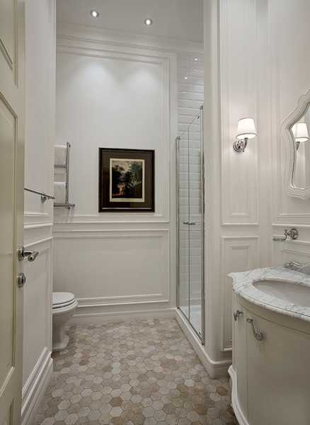 bathroom design with mosaic tiles and marble sink