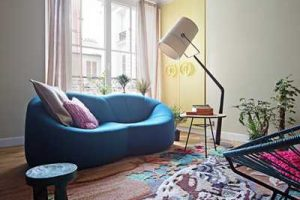 living room sofa in blue color and sculptured floor rug