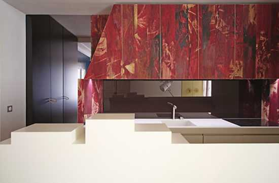 contemporary kitchen design with red wall panels
