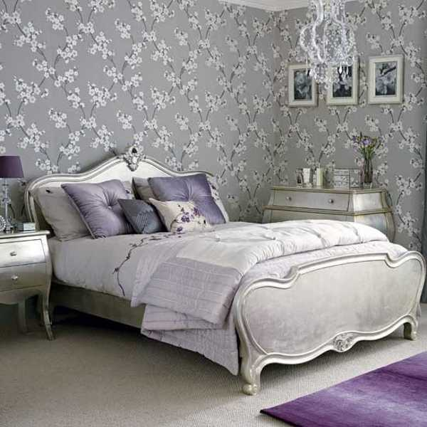 gray wallpaper and carved wood bedroom furniture decorative pillows