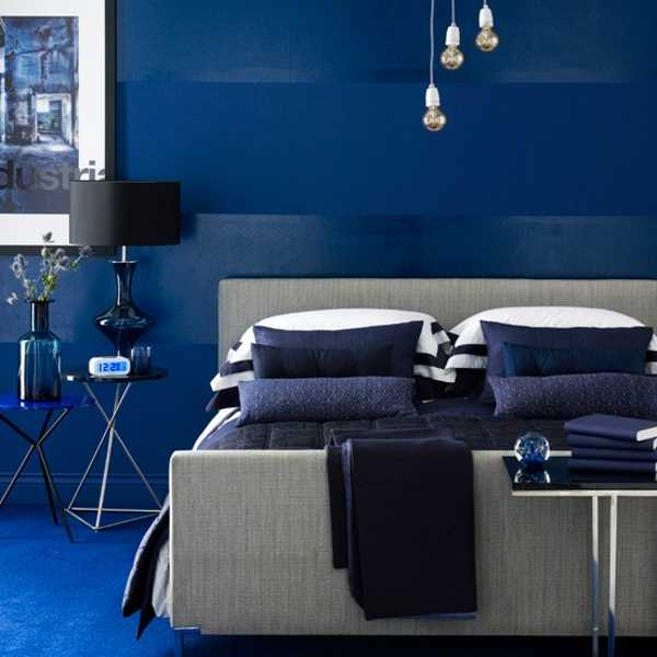 Deep Blue Wall Paint And Bedding For Modern Bedroom Decorating
