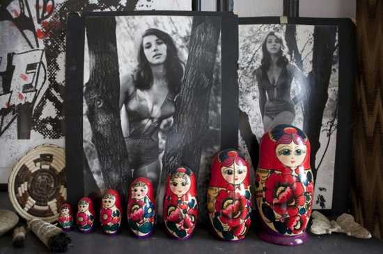 russian dolls and black and white photography for fireplace mantel decorating