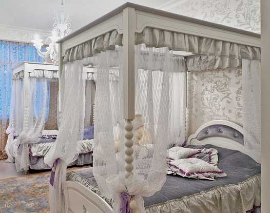 white bed with four posts in white color