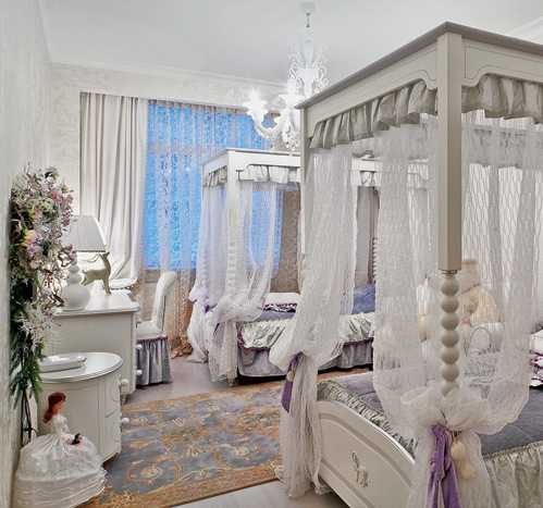 kids bedroom decorating with two four post beds in white