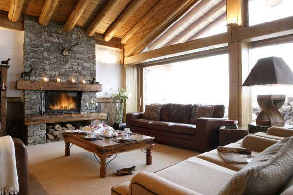 stone fireplace and wood ceiling design