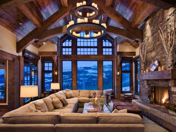living room design with stone fireplace and ceiling beams