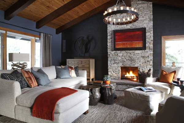 white living room furniture and stone fireplace