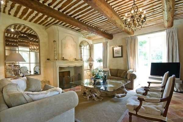 wood ceiling beams and vintage lamps for living room design in country home style