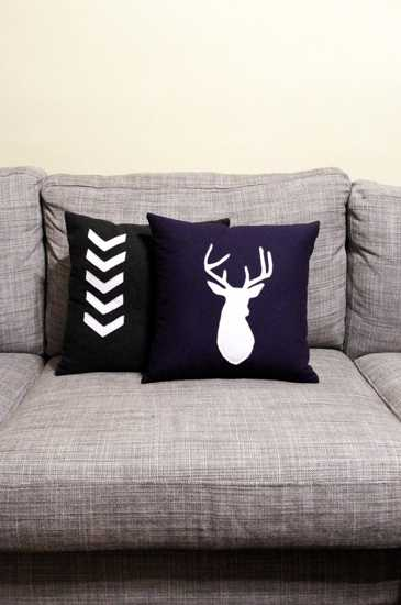 black pillows with white appliques