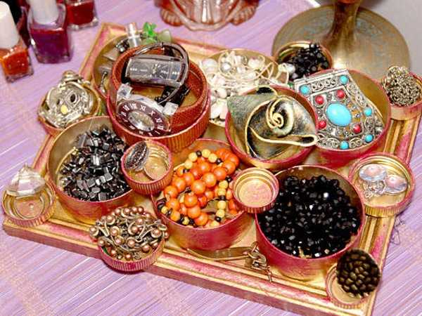 using containers and cups for jewelry storage