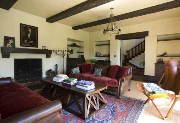 antique living room furniture and vintage decor accessories fireplace shelf decoration with an antique portrait - Antique Decor