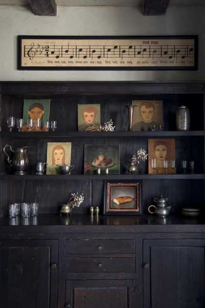 dining room shelves with antique portraits