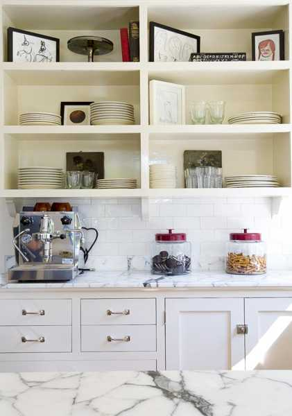 Kitchen Shelves With Antique Paintings