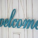 blue painted wooden letters, welcome