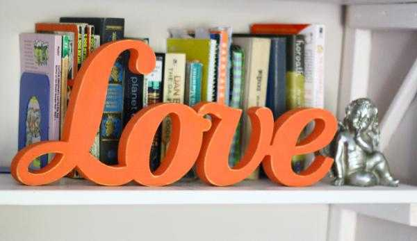 orange painted wooden letters love